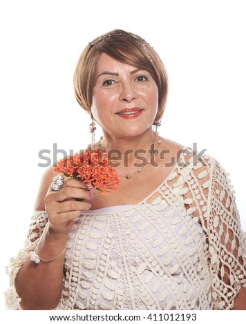 older lady posing with flowers on a white background - stock photo