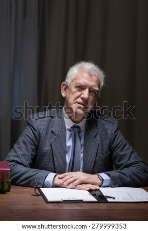 Older lonely businessman thinking about his past - stock photo