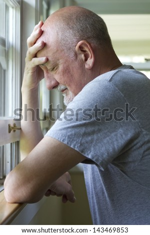 Older man expressing pain or depression. - stock photo