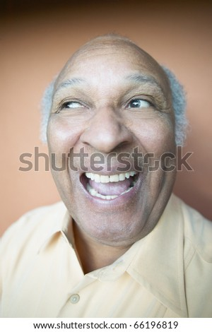 Older man smiling for the camera - stock photo