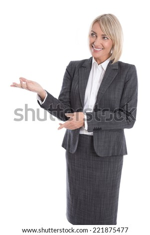 Older or mature isolated businesswoman presenting over white. - stock photo