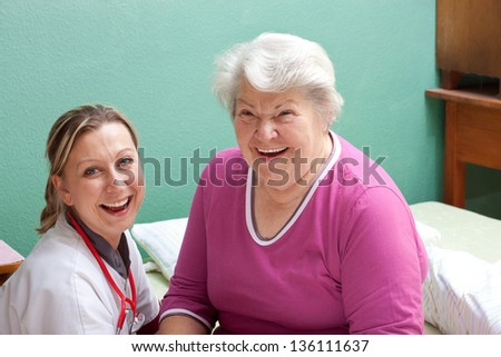 older Patient and doctor are smiling - stock photo