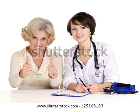 older woman came to the reception to the doctor - stock photo