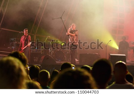 OLHAO, PORTUGAL - AUGUST 9: GNR performs onstage at seafood festival on August 9, 2012 in Olhao. - stock photo