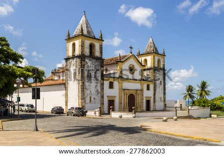 OLINDA, BRAZIL - MAY 14: View of Se Church in Olinda, PE, Brazil on a sunny day showcasing its historic architecture dated from the 17th century on a cobble stone street on May 14, 2015. - stock photo