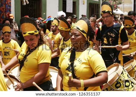 OLINDA, PERNAMBUCO/ BRASIL Â?Â? 19 FEBRUARY 2012 People during street parade during the frevo carnival in the old town of Olinda in Northeast of Brasil in 2012, one of important carnivals in Brasil. - stock photo