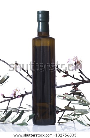 olive branch and a bottle of olive oil isolated on white background - stock photo