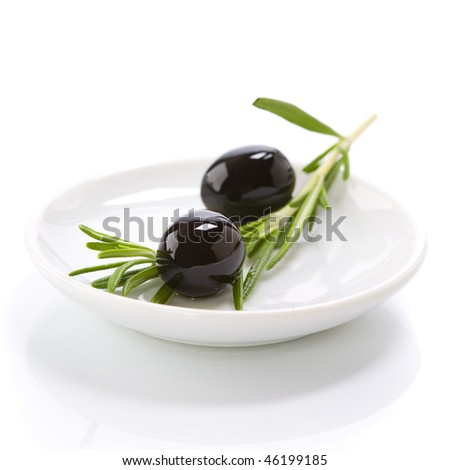 Olive branch and olive oil on white plate - stock photo