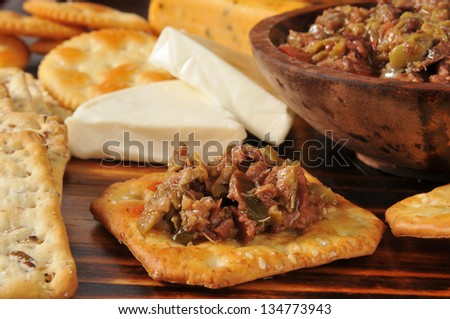 Olive bruschetta with pepper jack and cheddar cheeses and wheat crackers - stock photo