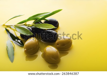Olive fruit in oil background close up - stock photo