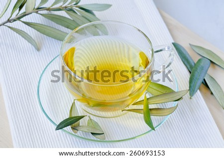 Olive leaf infusion. Alternative medicine.  Selective focus. Taken in daylight. - stock photo