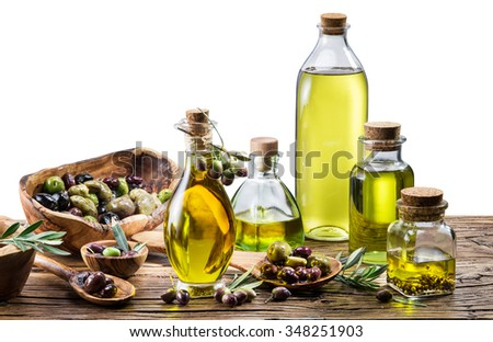 Olive oil and berries on the wooden table. white background. File contains clipping paths. - stock photo