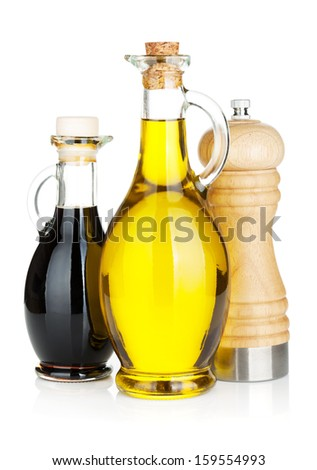 Olive oil and vinegar bottles with pepper shaker. Isolated on white background - stock photo