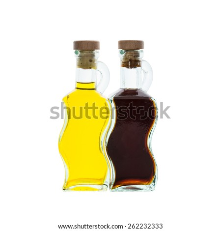 Olive oil and vinegar in glass bottles isolated over white - stock photo