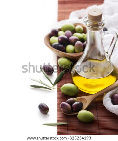 Olive oil bottle and olive fruit with copyspace - stock photo