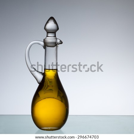 Olive oil bottle in back light. Copy space. - stock photo