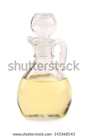 olive oil carafe closed on a white background - stock photo