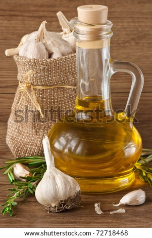 Olive oil, garlic, peppercorns and rosemary. - stock photo
