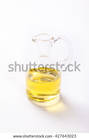 Olive oil in a bottle on white background - stock photo