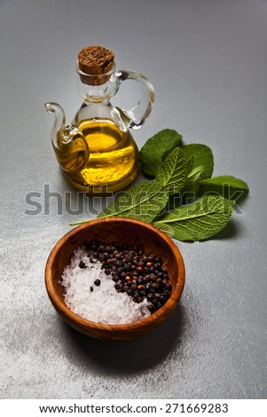 olive oil in a glass bottle. herbs. seasoning.ingredients - stock photo