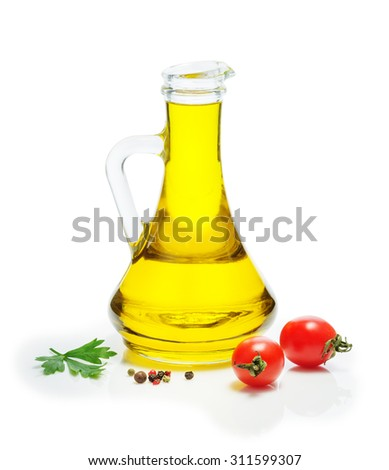 Olive oil in a glass jug, cherry tomatoes, a mixture of peppers, on a white background. Spices, herbs, vegetable oil. - stock photo