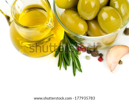 olive oil, olives and spices over white - stock photo