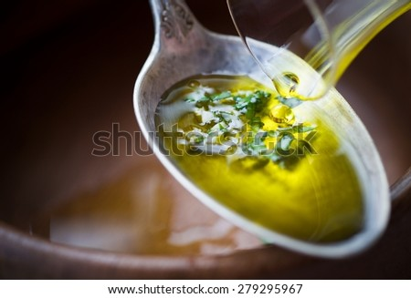 Olive Oil Poured Into Spoon with Spices Organic Vegan Food - stock photo