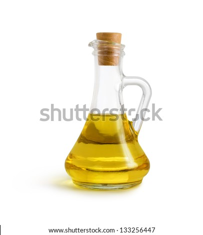 olive vegetable oil in glass pitcher isolated on white with clipping path included - stock photo