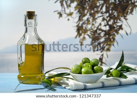 Olives and olive oil against Mediterranean landscape - stock photo