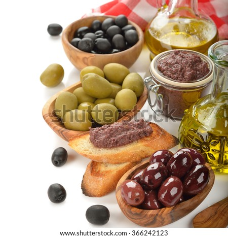 Olives and olive oil on a white background - stock photo