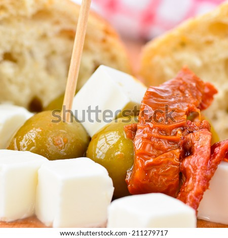 Olives, feta cheese and sundried tomatoes - stock photo