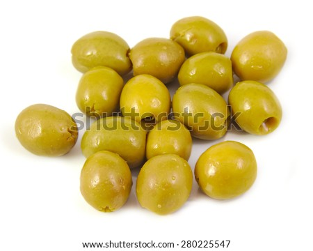 Olives filled with anchovy on a white background. Typical spanish tapa - stock photo