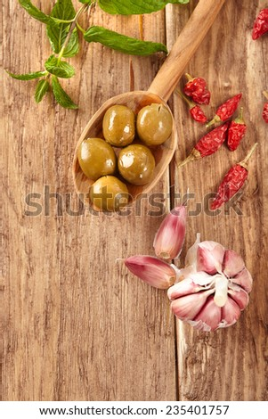 Olives, garlic, chilly peppers and mint - stock photo