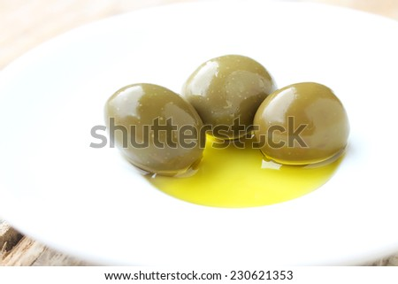 Olives in the oil - stock photo