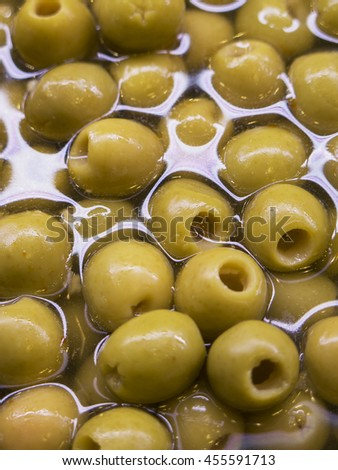 Olives in water, in a close up - stock photo