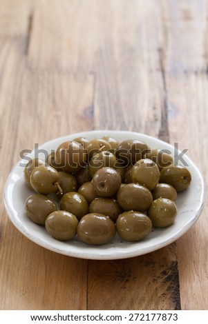 olives in white plate - stock photo