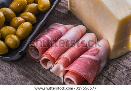 olives Prosciutto ham cheese delicacy - stock photo