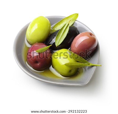 Olives with leaves isolated on white - stock photo