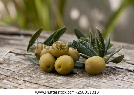 olives with olive leaves - stock photo
