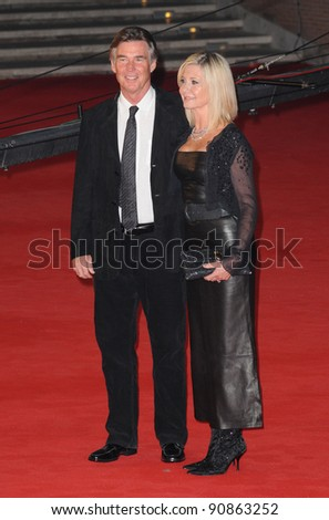 """Olivia Newton John and John Easterling at the premiere of """"A Few Best Men"""" during the 6th International Rome Film Festival. {month name}28, 2011, Rome, Italy Picture: Catchlight Media / Featureflash - stock photo"""