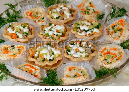 Olivier salad tartlets from appetizer table - stock photo