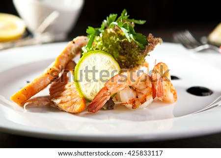Olivier Salad with Shrimp and Salmon - stock photo