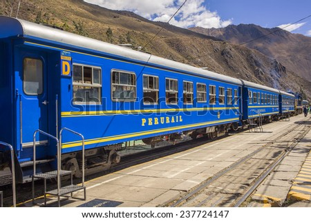 OLLANTAYTAMBO, PERU- JULY 22:Luxurious train with panoramic view from Ollantaytambo to Machu Picchu at a platform in the train station on July 22, 2014  - stock photo