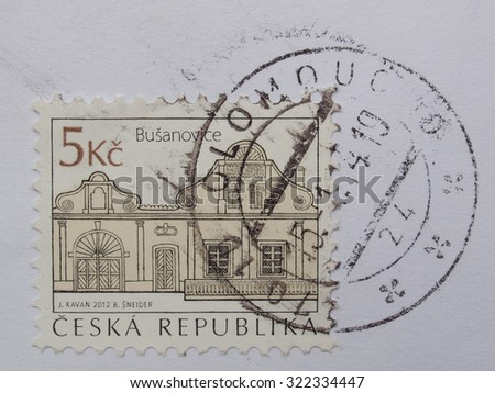 OLOMOUC, CZECH REPUBLIC - CIRCA AUGUST 2014: mail stamp showing the traditional architecture of Busanovice village - stock photo