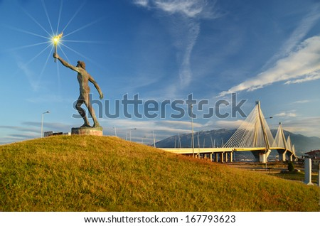 Olympic runner statue - Rio Antirio bridge Patra Greece - stock photo