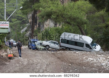 OLYMPOS, TURKEY - OCTOBER 14: Crashed cars and people in the woods after flood disaster on October 14, 2009 in Olympos, Turkey, Asia. The floods destroy  roads and houses and swept away about 50 cars. - stock photo
