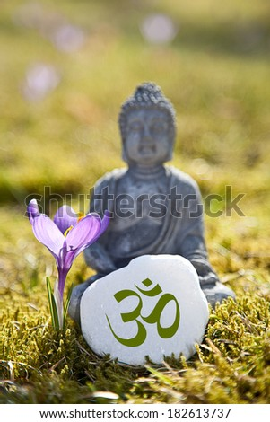 Om Sign with Buddha Statue - stock photo