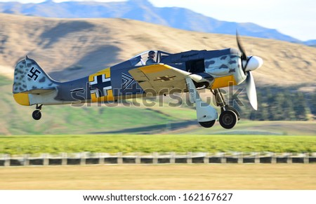 """OMAKA-APRIL 03:German Fockewulf FW190 aircraft in flight during the royal New Zealand air force """"Omaka airshow"""" on April 03, 2013 in Blenheim New Zealand - stock photo"""
