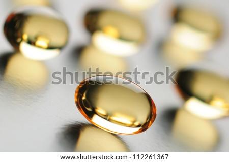 Omega 3 fish oil capsules close up. Differential focus. - stock photo