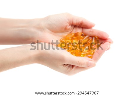 Omega 3 in female hands. Isolate on white. - stock photo